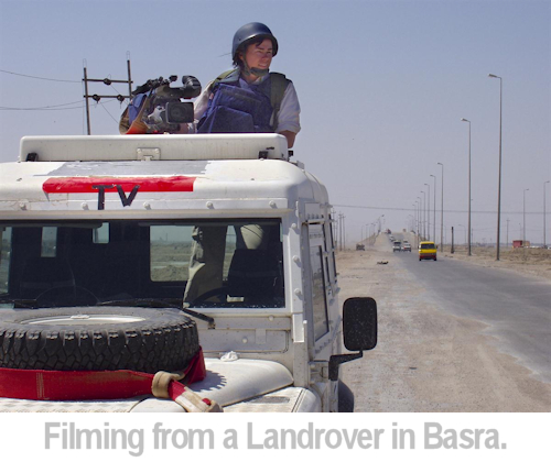 julie filming from a landrover in basra